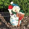 Hóember szobor táblával 123